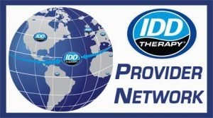 IDD Therapy Provider Network Logo a globe with logos on countries with providers