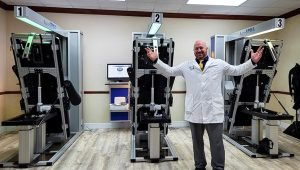 Dr. Graham Kern with his three IDD Therapy machines called Accu-SPINA