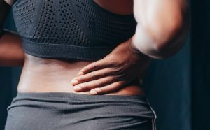 Image of person with lower back pain for IDD Therapy. Thank you to Kindel Media on Pexels